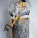Wood, glass, metal, twine, grass, acrylic paint, spotlight, magazine, 20 x 20 in x 8 ft (50 x 50 cm x 2.5 m)