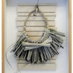 Leather, grass, felt, bone, blow-gun dart, wooden frame, 18.5 x 24.5 x 4 in (47 x 62 x 10 cm)