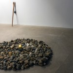 Ground floor with Slingshot (Orco's revenge) (2013) and Rock-pile (weather report) (2013) Stones, glazed ceramic brick on top of lead block, 72 in (1.8 m) in diameter