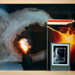 Archival print from video still, book, aluminum and Polaroid photograph, wooden frame, 13 x 17.5 in (33 x 44.5 cm)