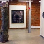 Installation view with Black Hole (2012), Archival print, wooden frame, 47.5 x 53 in (121 x 135 cm)